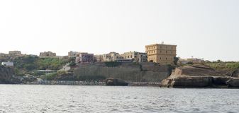 Ventotene. Island of Ventotene, seen from the sea, the houses near the port. Pontine Islands royalty free stock photography
