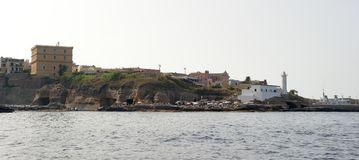 Ventotene. Island of Ventotene, seen from the sea, the lighthouse and the houses near the port. Pontine Islands stock photo