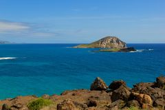Island view with blue ocean water Royalty Free Stock Photography