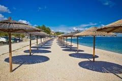 Island of Vir beach umbrellas Royalty Free Stock Photography
