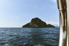 Island visible from a boat. Image an island in the Andaman Sea, thailand. View from out of a boat Royalty Free Stock Images