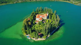 Island Visovac, aerial ascent shot Royalty Free Stock Photography