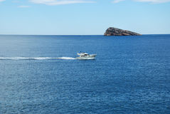 Island and yacht. A yacht sailing nearby and island Royalty Free Stock Photo