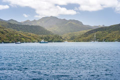 Island with yachts resting in a harbour Stock Photos