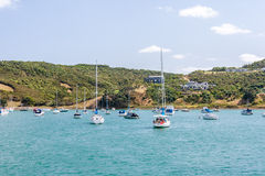 Island with yachts resting in a harbour Royalty Free Stock Photo
