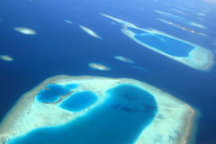 Islands. Photo from the hydroplane in Indian ocean, Maldives Stock Photo