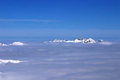 Are those islands?. No, they are mountaintops above the clouds Royalty Free Stock Photography