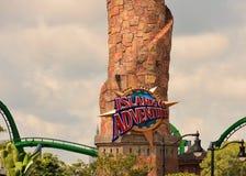 Islands of Adventure sign and green roller coaster at Universal Studios city walk. Orlando, Florida; August 13, 2018 Islands of Adventure sign and green roller stock photo