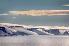 Arctic Islands Glaciers, snowfields and rock outcrops. Islands along British channel. Glaciers, icefall, outlet glacier, snowfields and rock outcrops. Franz Royalty Free Stock Images