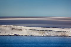 Arctic Islands Glaciers, snowfields, iceberg and rock outcrops. Islands along British channel. Glaciers, icefall, outlet glacier, snowfields and rock outcrops Stock Photo
