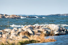 Islands in the archipelago and a lighthouse in the center far aw Stock Images
