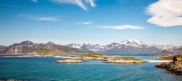 Islands on the background of mountains in Sommaroya, North Norway. Small islands on the background of mountains in Sommaroya, North Norway Royalty Free Stock Images