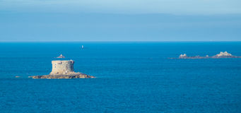 Islands close to guernsey. A view of some islands surrounding the Guernsey taken from a cruise ship Stock Photography