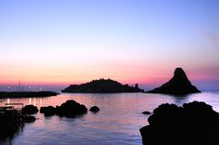 Islands of the Cyclops at Dawn Sicily Italy - Creative Commons by gnuckx royalty free stock images