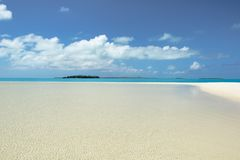 Absolute clear water, deep blue sky, white sand, perfect island in Pacific Ocean Royalty Free Stock Photo