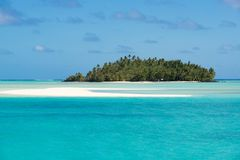Perfect island in turquoise clear water, deep blue sky, white sand, Pacific Island. Small islands of dreams in Tropes, South Pacific Ocean, Aitutaki, Cook Royalty Free Stock Photography