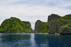 Islands of El Nido. The foliage-coated limestone formations of El Nido, Philippines royalty free stock images