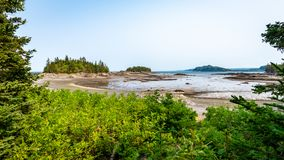 Islands and inlet at low tide, Quebec stock images