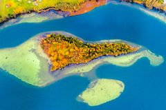 Islands on lake, aerial. Photography of beautiful Lithuanian scenic nature in fall Stock Image