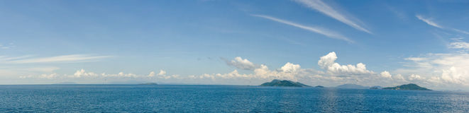 Islands in ocean panoramic. Panoramic view of islands in ocean  under cloudscape, Panama, South America Royalty Free Stock Photography