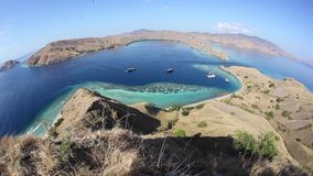 Islands and Reefs in Komodo National Park. The beautiful islands in Komodo National Park, Indonesia, are surrounded by flourishing coral reefs. This tropical stock video