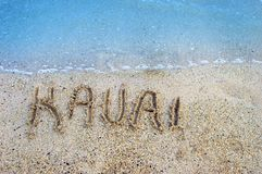 Islands in the Sand Kauai. Finger drawn letters withstand the gentle ebb and flow of the aqua waters of the Pacific Ocean surrounding the Hawaiian Islands. Kauai stock photography