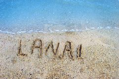 Islands in the Sand Lanai. Finger drawn letters withstand the gentle ebb and flow of the aqua waters of the Pacific Ocean surrounding the Hawaiian Islands. Lanai royalty free stock photos