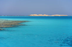 Islands in the sea. The red sea a coral reef, island on horizon Stock Image