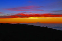 Islands in a sea of clouds at sunset Stock Images