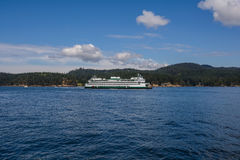 The islands and sea-going ferry. The islands and sea-going ferry on sunny day Stock Photo