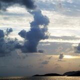 Islands in sea and sky with clouds at sunset Royalty Free Stock Photos