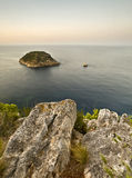 Islands seen from the top of a cliff. Two little islands seen from the top of a cliff, with the rocks of the mountain on the foreground Royalty Free Stock Photo