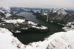 Islands With Snow Near Body of Water Stock Photo