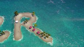 Islands in tropical sea in shape of the word summer. stock footage