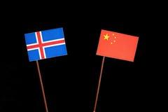 Islandzka flaga z chińczyk flaga na czerni fotografia royalty free