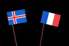 Islandzka flaga z francuz flaga na czerni obrazy stock