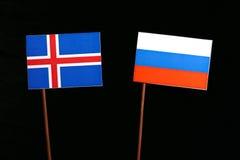 Islandzka flaga z rosjanin flaga na czerni obraz royalty free