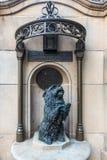 Islay dog statue near Queen Victoria statue, Sydney Australia. Sydney, Australia - February 12, 2019: Historic bronze statue of pet dog Islay of Queen Victoria royalty free stock photo