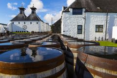 Ardbeg whisky distillery`s established in 1815, Islay, Scotland. ISLAY, SCOTLAND - SEPT 13 2017: Ardbeg whisky distillery`s established in 1815. The traditional royalty free stock photos