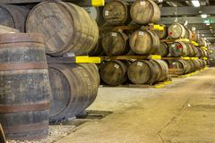 Lafroaig old wooden barrels and casks in cellar at whisky distillery in Scotland. ISLAY, SCOTLAND - SEPT 15 2017 : Old wooden barrels and casks at Lafroaig stock image