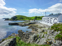Islay, Scotland - Sseptember 11 2015: The sun shines on Ardbeg distillery warehouse royalty free stock photo