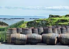 Islay, Scotland - Sseptember 11 2015: The sun shines on Ardbeg distillery warehouse. ISLAY, SCOTLAND - SEPTEMBER 11 2015: The sun shines on Ardbeg distillery royalty free stock image
