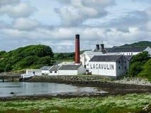 Islay, Scotland - Sseptember 11 2015: The sun shines on Lagavulin distillery warehouse. ISLAY, SCOTLAND - SEPTEMBER 11 2015: The sun shines on Lagavulin stock photo