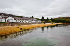 ISLAY, UNITED KINGDOM - 26 August 2013: Bunnahabhain distillery. Factory from the sea, Islay, United Kingdom royalty free stock images