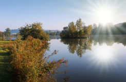 Isle. Blue lake with sunbeam and isle in the autumn Royalty Free Stock Image