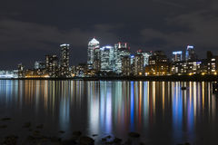 The Isle of Dogs at Night. A view of Canary Wharf and the Isle of Dogs, London from the river beach at Rotherhithe Royalty Free Stock Photos