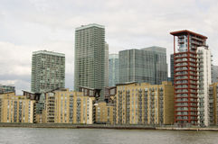 Isle of Dogs, viewed from the River Thames. Modern office and apartment blocks in the Canary Wharf district of the Isle of Dogs, part of London's Docklands Royalty Free Stock Photography