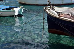 Isle of Hvar, Croatia. Old harbour fishing boats. View of the old main village harbour on Hvar island, Croatia. Fishing boats, crystal clear water Royalty Free Stock Photography
