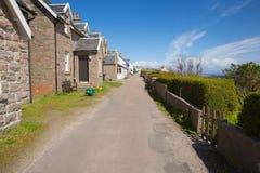 Isle of Iona Scotland uk Scottish island street with houses. In spring sunshine Stock Photo