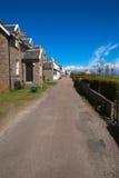 Isle of Iona Scotland uk Scottish island street with houses. In spring sunshine Stock Photos